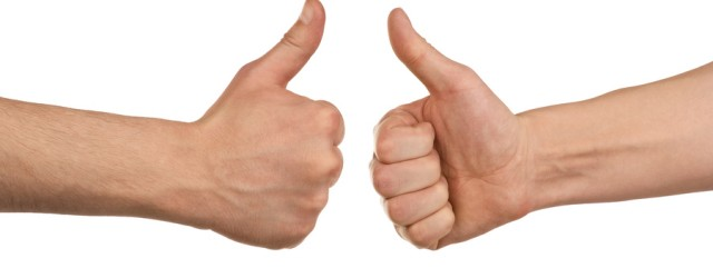 bigstock-Two-male-hands-showing-thumbs–26831501